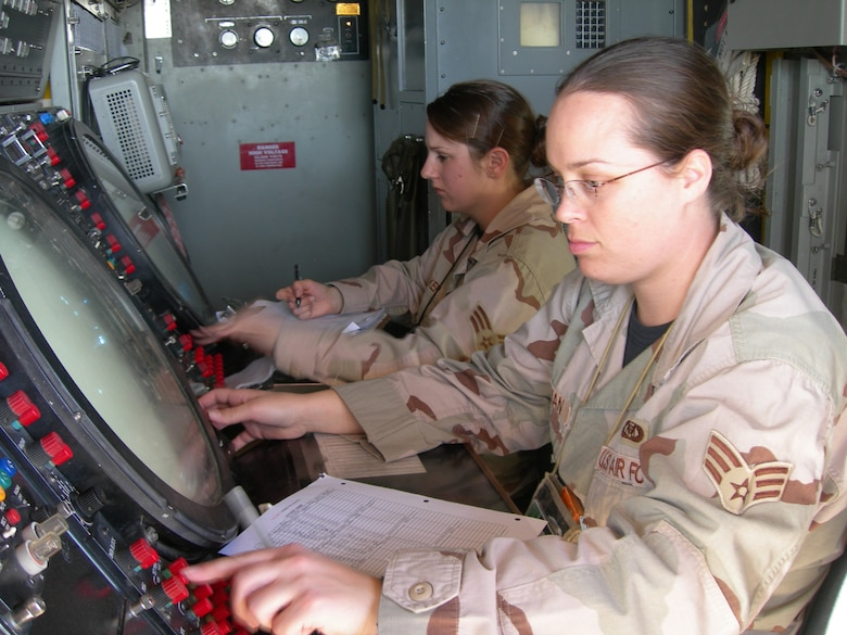 Balad Air Base, Iraq - Senior Airmen Amanda Hoffman and Rebekka Baker conduct an operational check of a AN/TPS-75 radar system at Balad Air Base, Iraq. Both Airmen are assigned to the 727th Expeditionary Air Control Squadron (EACS) and are deployed from the 728th Air Control Squadron at Eglin Air Force Base, Fla. Also known as Kingpin, the 727th EACS is responsible for maintaining positive control over aircraft operating in Iraq's 277,000 miles of airspace. (U.S. Air Force photo/Major Damien Pickart)