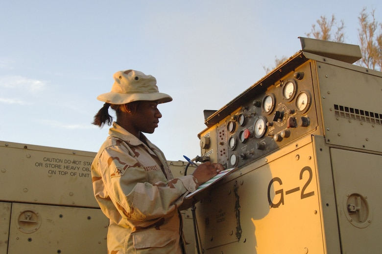 Balad Air Base, Iraq - Airman Yana Overstreet, an Air Ground Equipment (AGE) maintainer, conducts a routine systems check of a generator at Balad Air Base, Iraq. Airman Overstreet is assigned to the 727th Expeditionary Air Control Squadron (EACS) and is deployed from the 728th Air Control Squadron at Eglin Air Force Base, Fla. Also known as Kingpin, the self-sustaining 727th EACS is comprised of nealry 200 Airmen from 27 different Air Force specialties. AGE maintainers are critical to supplying unique power requirements to Kingpin's radar control equipment, ensuring positive control over aircraft operating in Iraq's 277,000 miles of airspace. (U.S. Air Force photo/Major Damien Pickart)