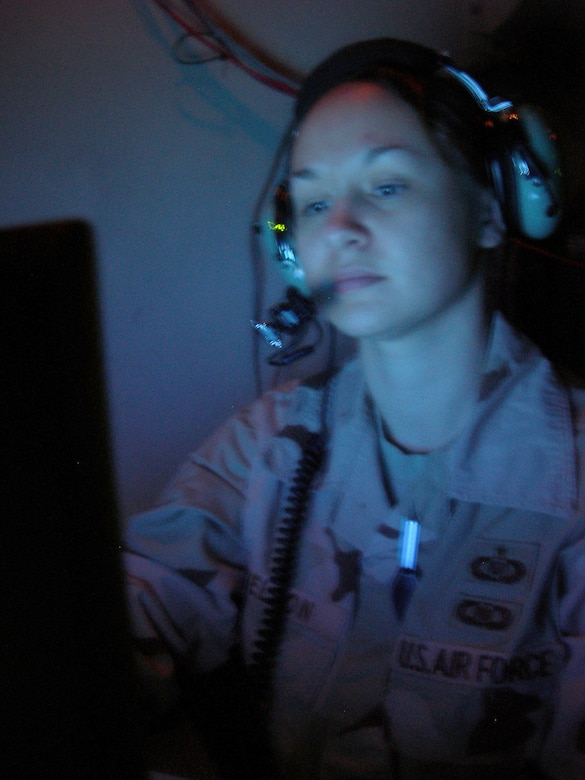 Balad Air Base, Iraq - Staff Sgt. Crystal Nelson, an enlisted weapons director, monitors OIF aircraft operations from inside an Operations Module van at Balad Air Base, Iraq. Sergeant Nelson is assigned to the 727th Expeditionary Air Control Squadron (EACS) and is deployed from the 728th Air Control Squadron at Eglin Air Force Base, Fla. Also known as Kingpin, the 727th EACS is responsible for maintaining positive control over aircraft operating in Iraq's 277,000 miles of airspace. (U.S. Air Force photo/Major Damien Pickart)