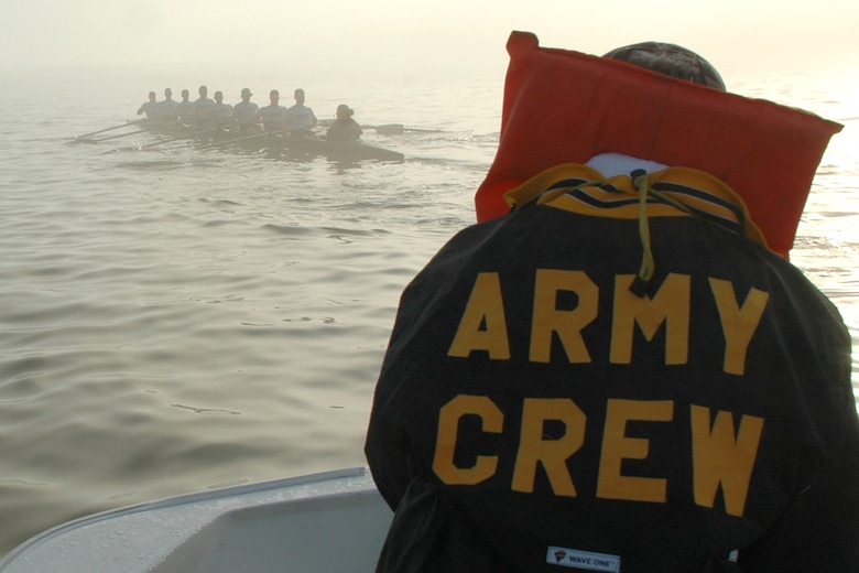 EGLIN AIR FORCE BASE, Fla. -- Jim Swisher, U.S. Military Academy Crew Team assistant coach, communicates to the men's varsity and novice squads through a thick fog on the Choctawhatchee Bay during an early morning workout March 13. The fog forced them to leave the bay and head for safer waters in the local bayous. The Army crew team is split up into four squads: men's varsity and novice, and women's varsity and novice. The team is here during their spring break to practice in the warmer Florida temperatures. (U.S. Air Force photo by Staff Sgt. Mike Meares)