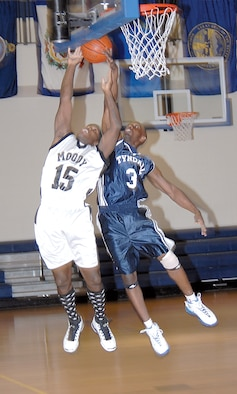 Airman Showers goes for a rebound against a Moody Flying Tiger during a conference game.