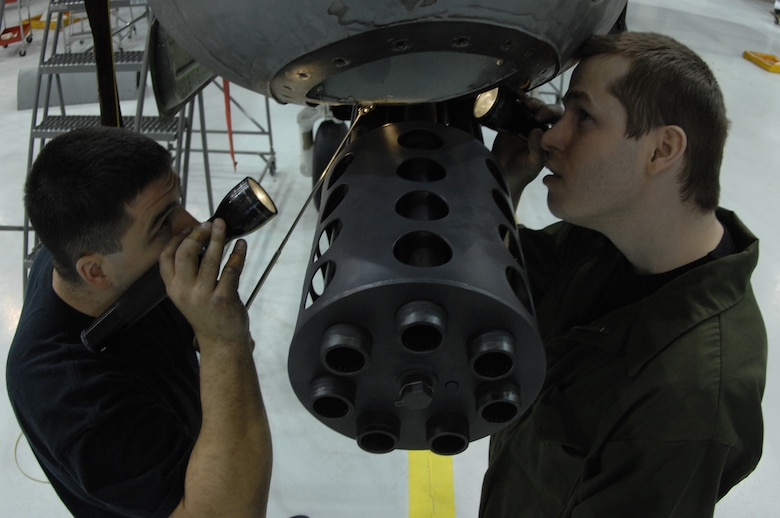 EIELSON AIR FORCE BASE, Alaska -- Staff Sgt Jason Belanger (left) and Senior Airman Timothy Jeter (right), both from the 354th Maintenance Squadron, inspect the nose section of an A/OA-10 Thunderbolt II during Phase maintenance on Mar. 13. Phase maintenance is an overhaul of the entire aircraft which ensures it is ready for safe flight.The 354th Maintenance Squadron is in charge of the Phase program and can turn an A-10 around in 10 days. (U.S. Air Force Photo by Staff Sgt Joshua Strang)