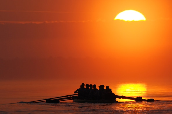 EGLIN AIR FORCE BASE, Fla. -- The sun awakens the eastern skyline as the U.S. Military Academy Crew Team men's varsity squad, sets out from Postal Point during an early morning workout March 13 in Choctawhatchee Bay. The team is split up into four squads: men's varsity and novice, and women's varsity and novice. The team is here during their spring break to practice in the warmer Florida temperatures. The men's varsity squad was ranked 20th in the nation at the end of last season. (U.S. Air Force photo by Staff Sgt. Mike Meares)
