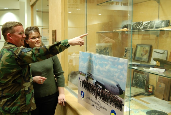 GRAND FORKS AIR FORCE BASE, N.D. – Staff Sgt. Brian O'Day shows his wife Sara a photo of a B-25 Mitchell bomber, the same type of aircraft his grandfather flew in as a tail gunner in WWII and later donated as a static display to the base.  (U.S. Air Force photo/Senior Airman J. Paul Croxon).
