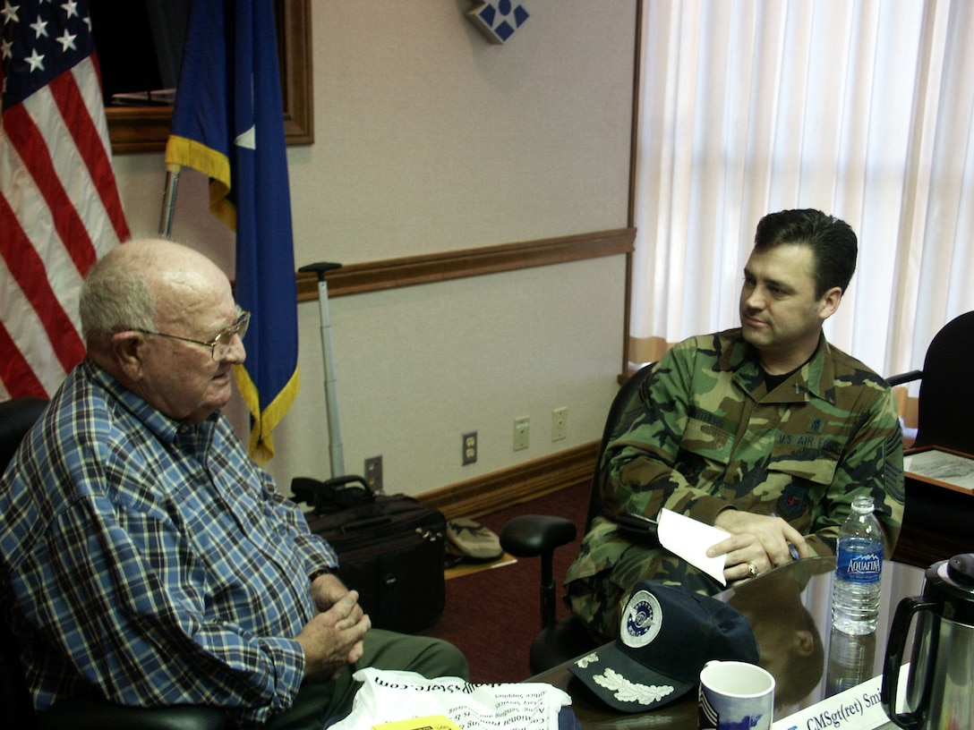 Retired Chief Master Sgt. Ray Smith (left), the first chief of the medical enlisted force, was at Wilford Hall Medical Center at Lackland Air Force Base, Texas, March 7 to meet the current chief of the medical enlisted force, Chief Master Sgt. Mark Withers.  Chief Withers, who was appointed in December, is visiting bases throughout the Air Force as part of a 'roll call' he has initiated for military medical service personnel.  (U.S. Air Force photo/Master Sgt. Kimberly Spencer)