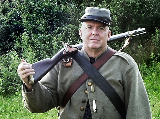 Maj. Warren Smith, Chief of Mobility and disaster preparedness with the 439th Aeromedical Evacuation Squadron, is also a private with the 34th Battalion Virginia Cavalry. The Civil War shooter is shown with his Whitney militia rifle.