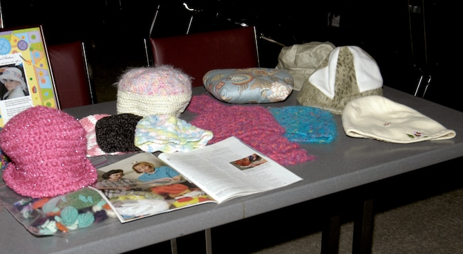 A small sample is shown of various crocheted hats and pillows made by Mad Hatters for recovering cancer patients at Wilford Hall Medical Center at Lackland Air Force Base, Texas. Mad Hatters was originally designed to make hats for recovering cancer patients dealing with hair loss from therapy. Now it's grown to accommodate other physical ailments, such as pillows for recovering mastectomy patients, and emotional ailments, such as clothes for stillborn babies being laid to rest. (USAF photo by Staff Sgt. Vincent Borden)