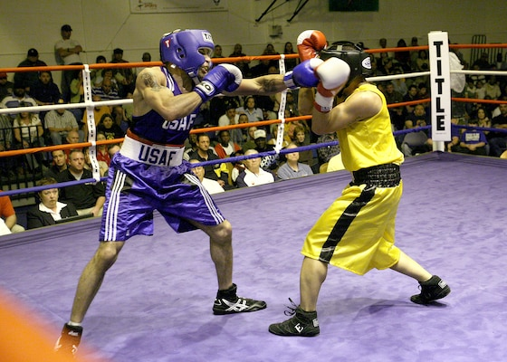 Rosey Summerville from Shaw AFB, S.C., throws a left jab at Christopher Munar from Fort Carson, Colo., during the U.S. Armed Forces Boxing Championship finals March 9 at Bennett Fitness Center on Lackland Air Force Base, Texas. (USAF photo by Robbin Cresswell)