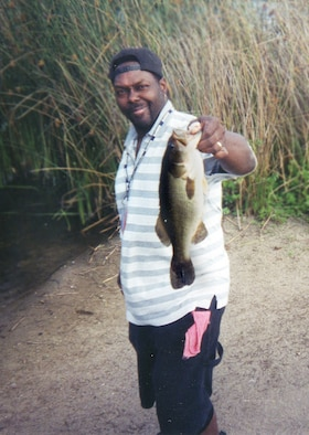 Eddie Kidd, a 100th Services Squadron school-age programs coordinator, holds up the 4-pound bass he caught in Marina, Calif., in April 2006. The biggest bass Mr. Kidd ever caught weighed 13.75 pounds -- more than three times the size of the fish shown here. Mr Kidd is competing in two Bassmaster Western Elite Series competitions in California -- the Duel in the Delta, March 22 to 25, followed by the Golden State Shootout, March 29 to April 1. The competitions are for the top professionals and co-anglers of the Bassmasters Division. The heaviest fish he ever caught was a 155-pound catfish, in July 2000.