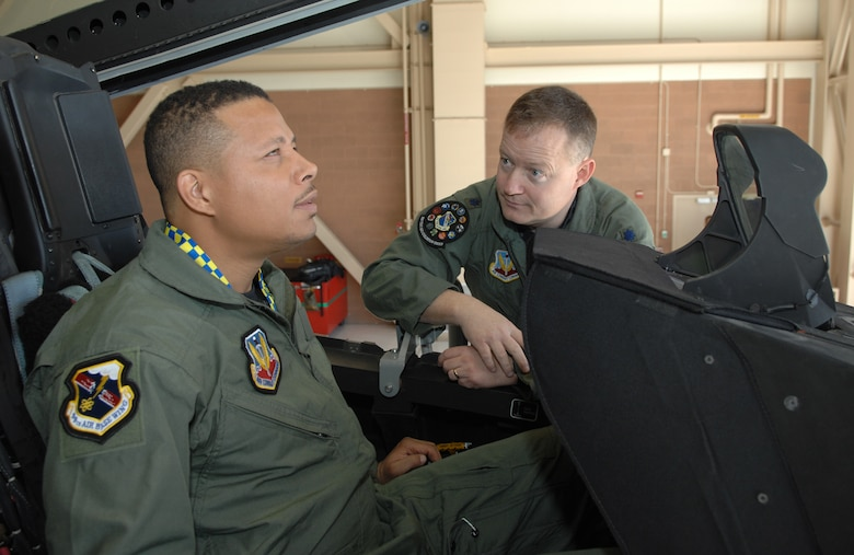 """Lt. Colonel Dave Rose, 53rd Test and Evaluation Squadron deputy commander, briefs Oscar-nominated actor Terrence Howard on the F-22 Raptor at Nellis Air Force Base, Nev. on March 16. Mr. Howard will be starring in  """"Iron Man,"""" which begins filming soon. The U.S. Air Force will be depicted in a number of scenes in the film. (U.S. Air Force photo by Tech. Sgt. Scottie McCord)"""