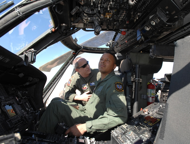 """Maj. Yonel """"Yogi"""" Dorelis, 66th Rescue Squadron pilot, briefs Oscar-nominated actor Terrence Howard on the HH-60G helicopter at Nellis Air Force Base, Nev. on March 16. Mr. Howard will be starring in  """"Iron Man,"""" which begins filming soon. The U.S. Air Force will be depicted in a number of scenes in the film. (U.S. Air Force photo by Tech. Sgt. Scottie McCord)"""