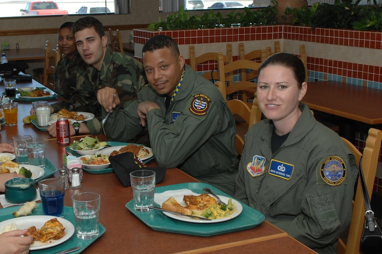 """Oscar-nominated actor Terrence Howard has lunch with  Airmen at the Crosswinds Dining Facility """" at Nellis Air Force Base, Nev. on March 16. Mr. Howard will be starring in  """"Iron Man,"""" which begins filming soon. The U.S. Air Force will be depicted in a number of scenes in the film.  (U.S. Air Force photo by Tech. Sgt. Scottie McCord)"""