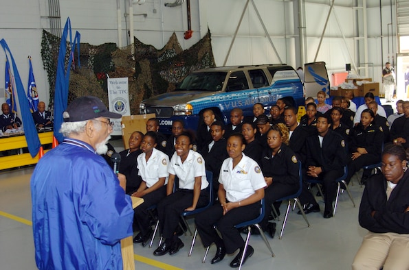 Mr. Val Archer, an original Tuskegee Airman who served during World War II and retired from the Air Force, speaks to Navy Junior Reserve Office Training Corps during JROTC week at Dobbins ARB.  Nearly 5,000 students visited Dobbins during a four-day period for C-130 orientation flights, aircraft displays, Air Force career exhibits and various other displays. (U.S. Air Force photo/Master Sgt. Stan Coleman)