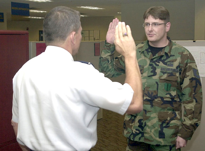 Maj. General Michael Gould, 2nd Air Force commander, administers the Oath of Enlistment to then-Tech. Sgt. Derrick Lepper of the 17th Mission Support Group, just before promoting him to master sergeant March 8.  Master Sgt. Lepper was promoted under the Stripes for Exceptional Performers program.  (U.S. Air Force photo by Airman 1st Class Stephen Musal)
