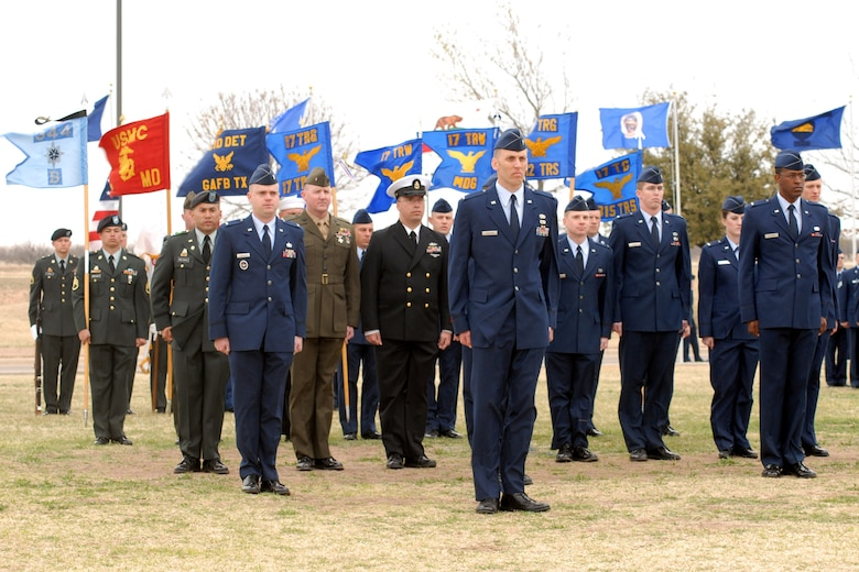 Goodfellow servicemembers gather cerimoniously at the center of the base parade grounds during pass and review.  (U.S. Air Force photo by Staff Sgt. Angela Malek)
