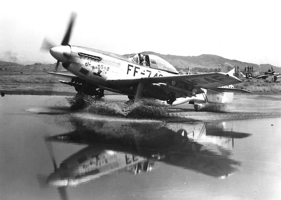 F-51 Mustang taxis through a puddle. (U.S. Air Force photo)