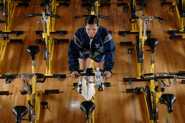 Staff Sgt. Irene Noriega assigned to the 62nd Airlift Wing at McChord Air Force Base, Wash., participates in a zero-impact, fat burning, full body cardiovascular workout spin class March 9 at the McChord fitness center annex. (U.S. Air Force photo/Abner Guzman)