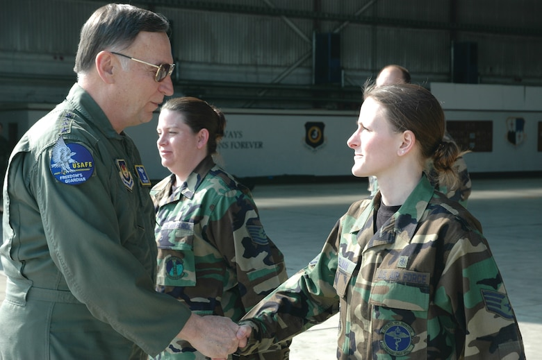 SPANGDAHLEM AIR BASE, Germany -- Gen. Tom Hobbins, U.S. Air Forces in Europe commander, meets Staff Sgt. Sharon Wellman, 52nd Medical Operations Squadron, while at Spangdahlem Air Base to shoot an American Forces Network commercial here March 15.