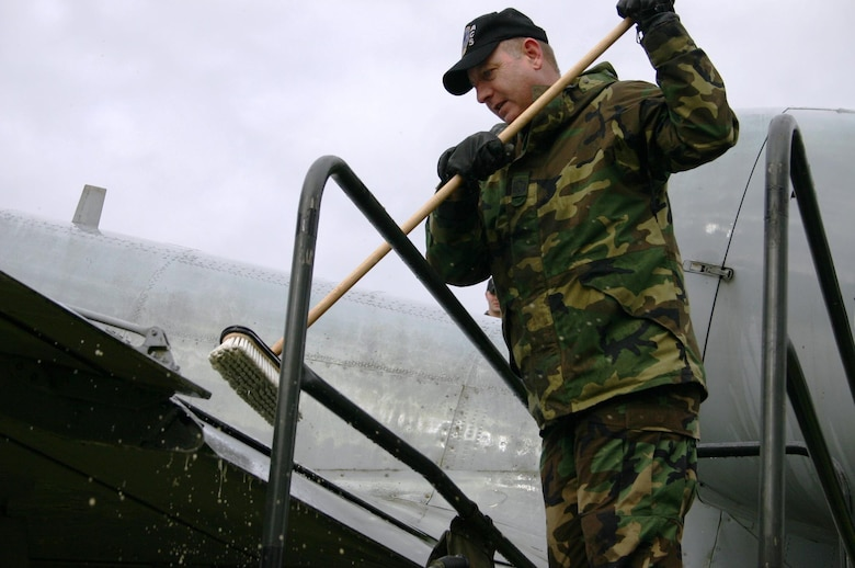 SPANGDAHLEM AIR BASE, GERMANY -- Senior Master Sgt. Roger Bolish, 606th Air Control Squadron, was one of approximately 20 volunteers from the 606th ACS to wash an A-10 at Spangdahlem's Air Park March 9.  (Photo by Staff Sgt. Daniel Heise)