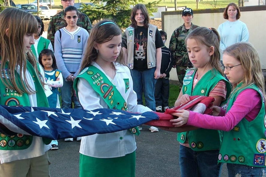 SPANGDAHLEM AIR BASE, GERMANY -- Left to Right, Mikayla DeMers, Alexis Quinones, Kaitlin King and Amber Couturier fold the Spangdahlem Middle School flag. Alexis, Kaitlin and Amber are all members of Junior Troop 198. Mikayla is a member of Junior Troop 702. This year the Girl Scouts have held a crime scene investigation workshop, celebrated World Thinking Day, were involved with Operation Open Arms and more. For more information about base Girl Scout Troops, e-mail spangdahlemgirlscouts@hotmail.com. (Photo by Kimberly Shock)