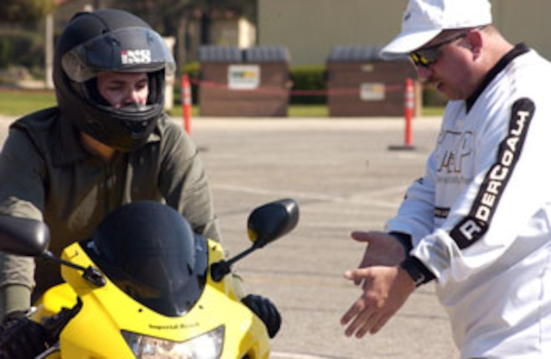 Instructor Gene Reeks gives Senior Airman Jaime Hinojosa-Guzman,