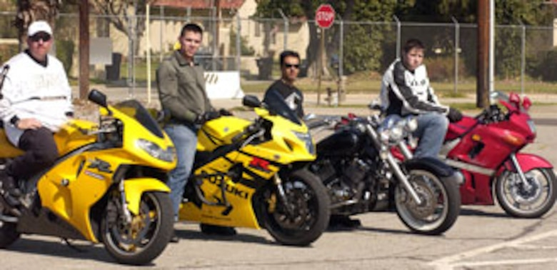 (Left to right) Volunteer instructor Gene Reeks, certified by the Motor Safety Foundation, students Senior Airman Jaime Hinojosa-Guzman, 452nd Logistics Readiness Squadron, Staff Sgt. Maro Mercado, 452nd Aircraft Maintenance Squadron and Caleb Hewitt, civilian contractor with the 163rd Reconnaissance Wing teach new riders at March Air Reserve Base. (U.S. Air Force photo by Staff Sgt. Amy Abbott)