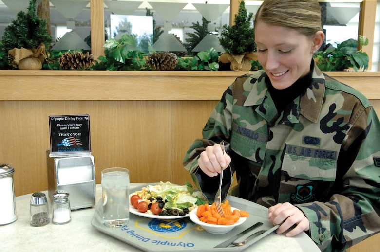 MCCHORD AIR FORCE BASE, Wash. -- Airman 1st Class  Lori Fiorello, 62nd Comptroller Squadron, enjoys a meal March 13, 2007 at the Olympic Dining Facility located in Building 578. (U.S. Photo/Abner Guzman)