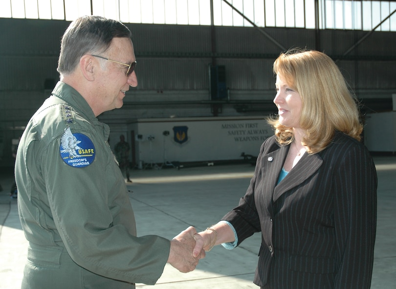 SPANGDAHLEM AIR BASE, Germany -- Gen. Tom Hobbins, U.S. Air Forces in Europe commander, meets Joan Siler, 52nd Mission Support Squadron, while at Spangdahlem Air Base to shoot an American Forces Network commercial here March 15.