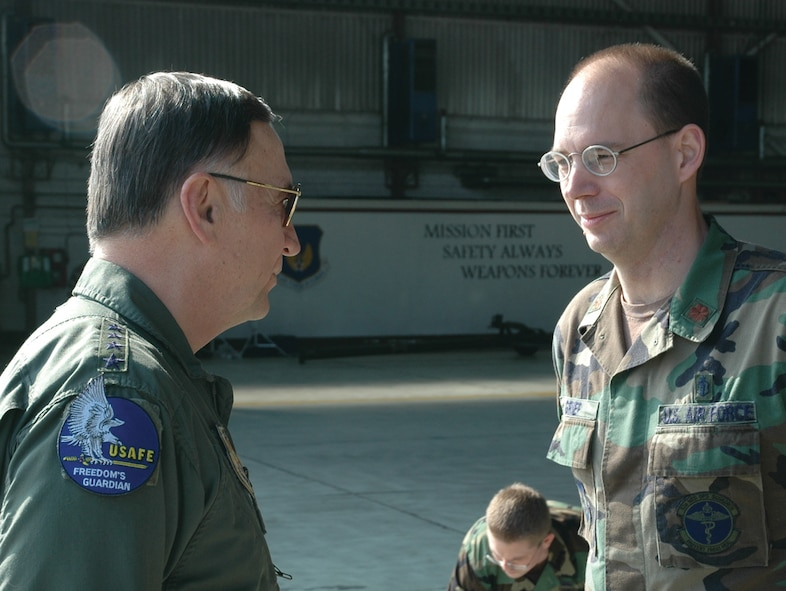 SPANGDAHLEM AIR BASE, Germany -- Gen. Tom Hobbins, U.S. Air Forces in Europe commander, meets Maj. Stephen Griep, 52nd Medical Operations Squadron, while at Spangdahlem Air Base to shoot an American Forces Network commercial here March 15.