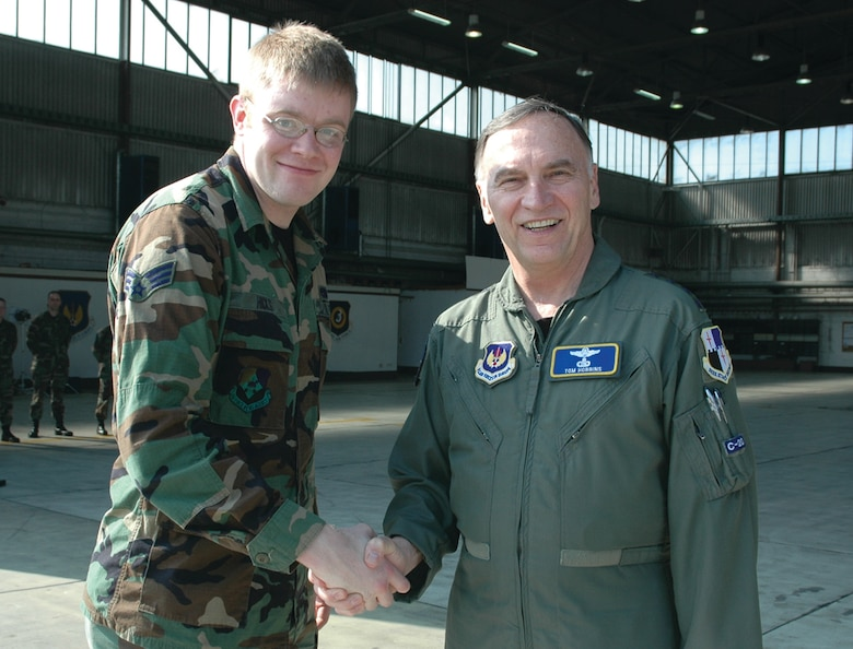 SPANGDAHLEM AIR BASE, Germany -- Gen. Tom Hobbins, U.S. Air Forces in Europe commander, meets Senior Airman Daivd Hicks, American Forces Network, Detachment 9, while at Spangdahlem Air Base to shoot an American Forces Network commercial here March 15.