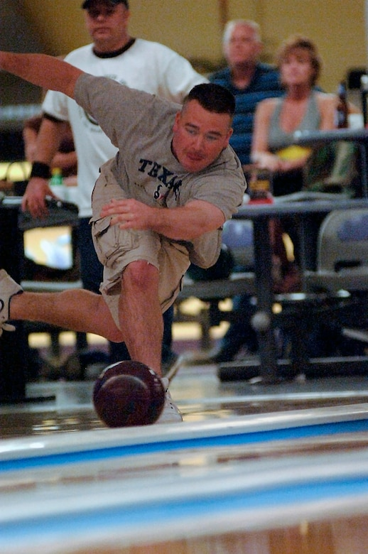 Kirtis Bailey, 437th Logistics Readiness Squadron, aims to pick up a spare during the second day of the bowl-off. (RELEASED)(U.S. Air Force photo by Airman 1st Class Nicholas Pilch)