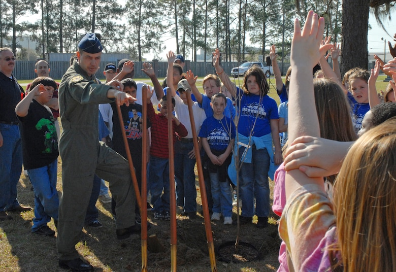 Col. Steven Harrison, 437th Airlift Wing vice commander, selects students from area schools to assist him in planting a tree for Earth Day celebrations March 21 at the base picnic grounds. Nearly 700 fifth-graders from local elementary schools attended the event. (U.S. Air Force photo/Airman Melissa B. Harper)