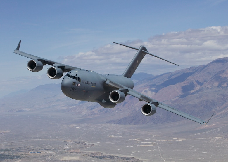 The C-17 Globemaster III T-1 flies over Owens Valley, Calif., for a test sortie. Edwards welcomed home the aircraft after 208 days of life extension modifications in San Antonio. T-1 is the first Air Force C-17 built to perform developmental testing. The aircraft is scheduled to perform flight testing to include airdrop improvements and core-computer replacement testing. (Air Force photo)