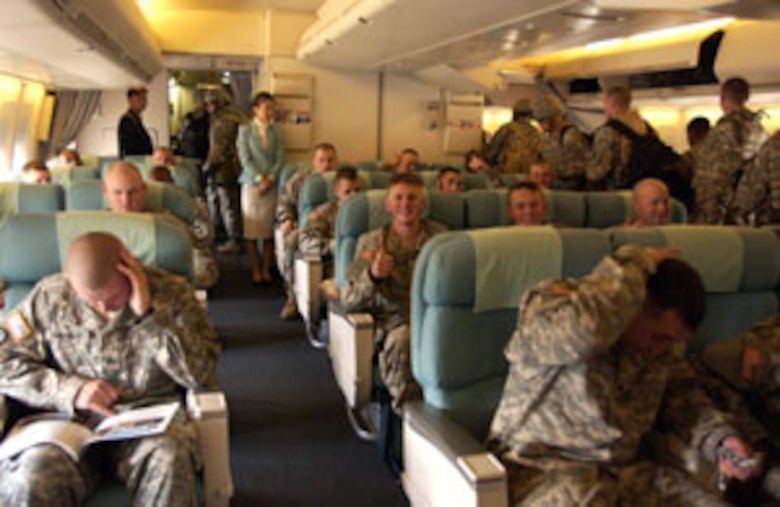Soldiers from Fort Irwin, Calif., get comfortable on a Korean Air  747 before it departs March Air Reserve Base, Calif.  The aircraft landed Wednesday at March ARB to pick up passengers making it the first time a Korean airlines aircraft physically has been exercised as part of the 26 year Mutual Airlift Support Agreement between the Department of Defense and the South Korean Air Force.  (U.S. Air Force photo by Staff Sgt. Amy Abbott, 452 AMW/PA)