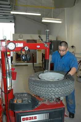 Airman 1st Class Daryl Bascom disbands and repairs a tire. The members of the 341st Logistics Readiness Squadron's vehicle maintenance shop are responsible for the upkeep of 800 government vehicles at Malmstrom. For more coverage, see pages 10-11.