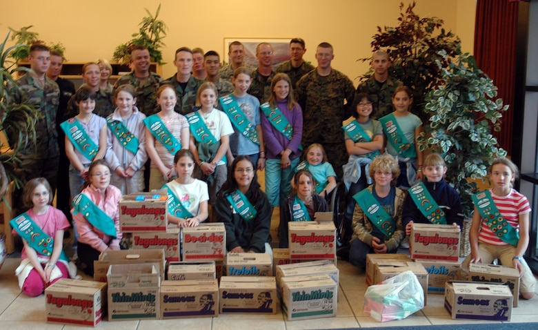 BUCKLEY AIR FORCE BASE, Colo. -- Local Girl Scouts from troop 679 donated close to 300 boxes of a variety of the popular cookies to the residents of Panther and Patriot Hall here March 21. The girls were recognizing their Hometown Heroes, which are the people and organizations that help make communities better places to live. Heroes include fire fighters, police, food banks, shelters and armed forces personnel stationed in United States and overseas. In 2006, the Girl Scouts in the Mile Hi Council donated more than 20,000 boxes of cookies to men and women serving in the armed forces. (U.S. Air Force photo by Staff Sgt. Sanjay Allen)