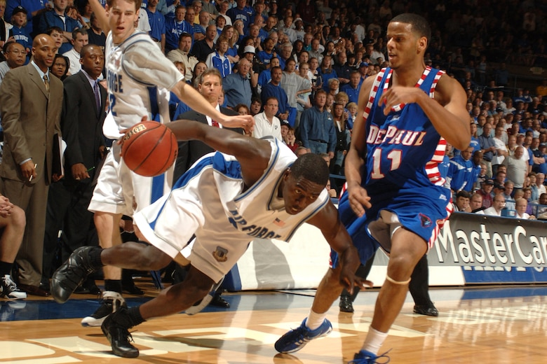 Falcon forward Dan Nwaelele eyes a path past DePaul's Sammy Mejia March 21 at Clune Arena. Nwaelele scored 10 points in Air Force's 52-51 win and a berth in the NIT semifinals in New York's Madison Square Garden March 27 against Clemson. (U.S. Air Force photo/Joel Strayer)