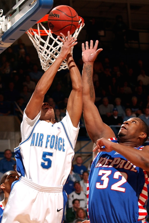 Falcon guard Matt McCraw battles DePaul center Lorenzo Thompson for a rebound March 21 at Clune Arena.  McCraw and Jacob Burtschi each had a team high eight rebounds in Air Force's 52-51 win giving the bluesuiters a berth in the NIT semifinals in New York City's Madison Square Garden March 27 against Clemson. (U.S. Air Force photo/Danny Meyer)