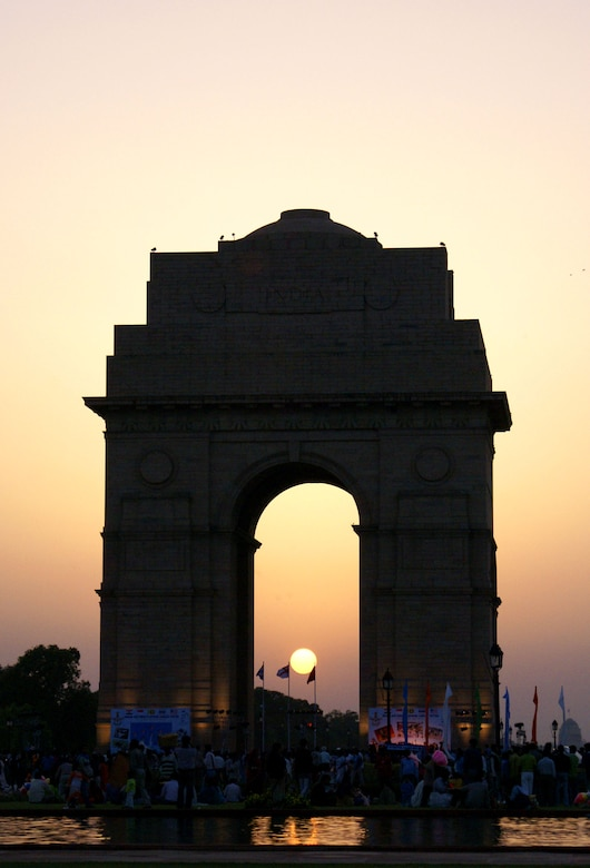 The sun sets behind the India Gate in New Delhi March 17, setting the stage for the evening portion of the Indian Air Force Platinum Jubilee Tattoo. The Pacific Air Forces rock band Pacific Trends was invited to take part in the multinational celebration, which included military bands from India, Singapore, Sri Lanka and Thailand. The IAF celebrates its 75th birthday this year. (U.S. Air Force photo/Marine Cpl. Ashleigh Bryant)