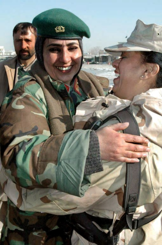 Gen. Myhammadzai Khatul hugs Senior Master Sgt. Elizabeth Melahn in Afghanistan after learning about the sergeant's donation of heating fuel for Afghani civilians. (Courtesy photo)