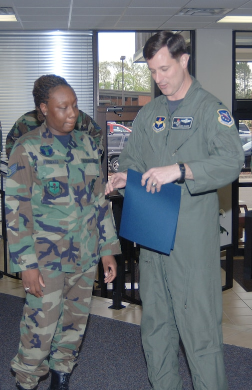 Tech. Sgt. Kimona Woodard, 14th Medical Support Squadron, was surprised by Col. Mark Baker, 14th Flying Training Wing Vice Commander, with a Stripes to Exceptional Performers promotion Monday at the 14th Medical Group clinic. She was promoted in front of the entire 14th Medical Group during what she believed was a brief on an upcoming exercise.