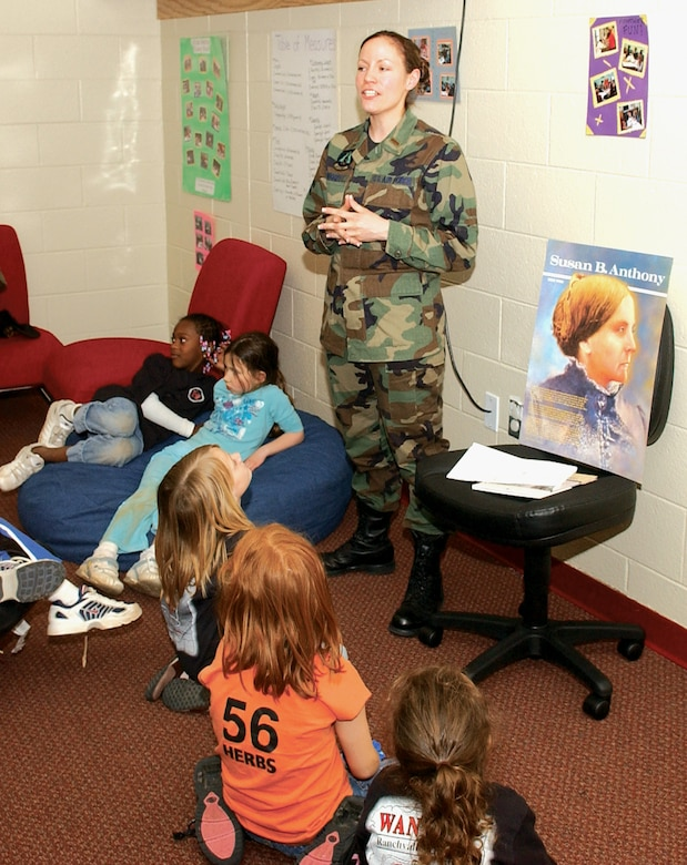 2nd Lt. Coulette Swiggert, 27th Component Maintenance Squadron, speaks to children at the Cannon Youth Center on March 14 about the contributions of Susan B. Anthony. Cannon Airmen spoke to the children about significan women in America during  Women's History Month presentations on March 14 and 21. (U.S. Air Force Photo by Tech Sgt. Scott MacKay)