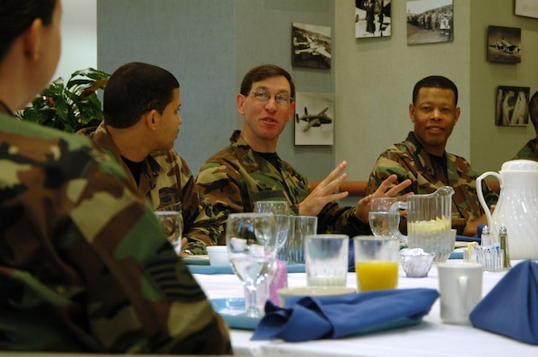 Col. Stephen Tanous, 30th Space Wing commander, and Command Chief Timothy Gordon, 30th Space Wing command chief, chat with 20 Airmen who were chosen to eat breakfast with the new wing commander at Breakers Dining Facility, March 22.  The breakfast gave wing leadership the chance to answer Airmen's questions such as those that pertain to cost of living allowance, base gas prices and eligibility to move off base for junior enlisted.  In December 2006, a question raised during the breakfast affected the entire Department of Defense, when a Vandenberg Airmen brought her concern about the Child Development Center to wing leadership.  Since then, CDC's no longer include combat duty pay when calculating the cost for child care. (U.S. Air Force photo by Senior Airman Stephen Cadette)