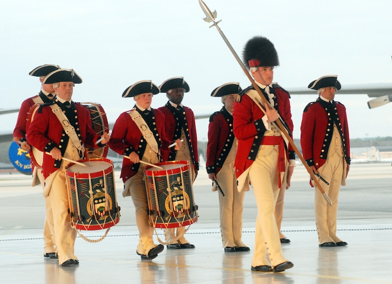 The Old Guard Fife and Drum Corps perform in uniforms patterned after Gen. George Washington's Continental Army. The group reenacted the custom of the Tattoo. U. S. Air Force photo by Sue Sapp