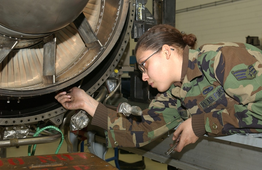 SPANGDAHLEM AIR BASE, GERMANY --  Senior Airman Jacquelynn Mathews, 52nd Component Maintenance Squadron propulsion journeyman, installs a low pressure turbine on engine 9574 for an F-16 here Tuesday. She's helping to prep the engine for movement as a result of the Lean team's redesigned/improved layout of the jet engine shop. The Lean Event, which began Monday, a week-long event, is a re-look (first one in the wing) at the engine production process which will build on and validate improvements made during the shop's original Lean event which took place here in February 2006. (US Air Force photo/Airman 1st Class Emily Moore)