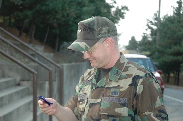 OSAN AIR BASE, Republic of Korea --  Col. Sean Cassidy, 607th Air Support Group commander, checks his pedometer to see how many steps he's taken Oct. 20. (U.S. Air Force photo by 2nd Lt. Kim Schaerdel)