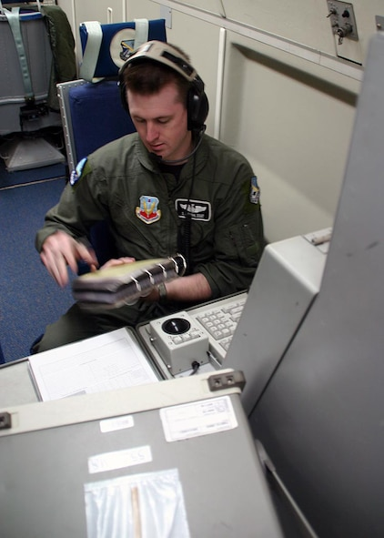 (TINKER AIR FORCE BASE, OKLA) Staff Sgt. Stephen Quinn, 960th Airborne Air Control Squadron airborne radar technician, performs his system checks during the E-3 Sentry 30th anniversary flight on Mar. 23.  The E-3 first arrived at Tinker on Mar. 23, 1977, and Airmen have been conducting the same aerial surviellance mission for the past 30 years. (Air Force photo by Staff Sgt. Stacy Fowler)