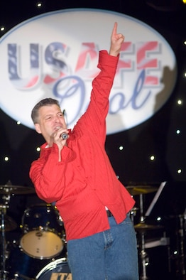 """Master Sgt. Douglas Gosselin strikes a pose during last year's United States Air Forces in Europe's """"USAFE Idol"""" talent contest. Sergeant Gosselin's high energy performance stole the show at base level and he walked away third place during the USAFE-level competition. This year's competition is 7 p.m., March 29 at the base theater. (U.S. Air Force photo Master Sgt. John Lasky)"""