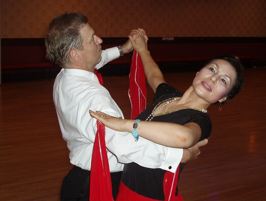 OSAN AIR BASE, Republic of Korea --  Mr. Dave Mosely dances with his Korean partner, Ms. Chung, Kum-Sun, in the Agape Club Ballroom in Seoul. (Courtesy photo)