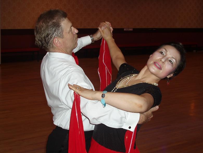 OSAN AIR BASE, Republic of Korea --  Mr. Dave Mosely dances with his Korean partner, Ms. Chung, Kum-Sun, in the Agape Club Ballroom in Seoul. (Courtesy photo)